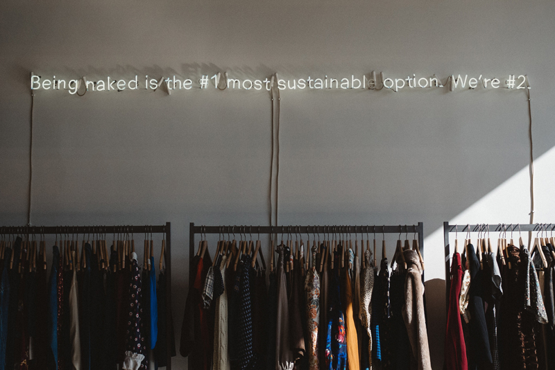 clothes hanging in boutique