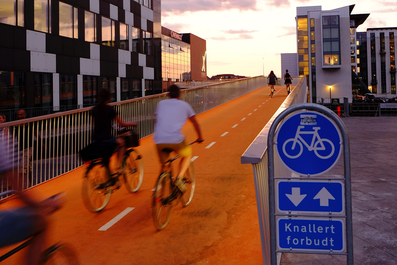 people riding bicycles in bicycle lane in denmark