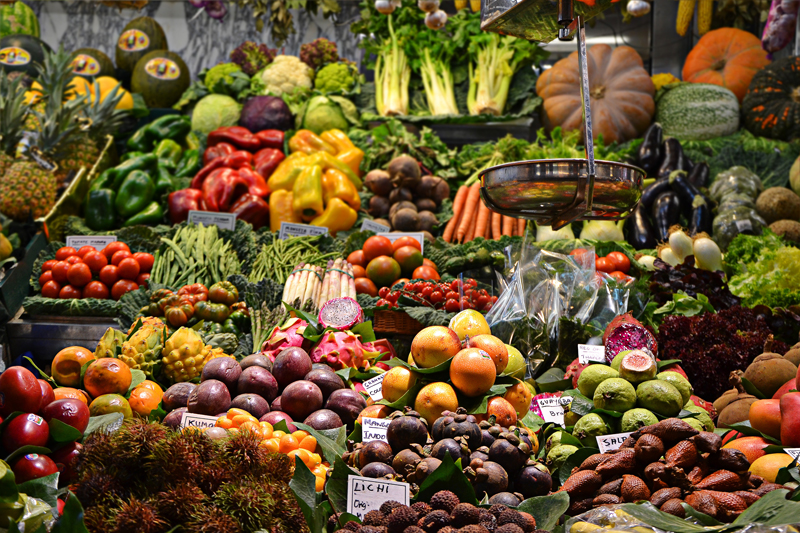 vegetables and fruit on display at a market