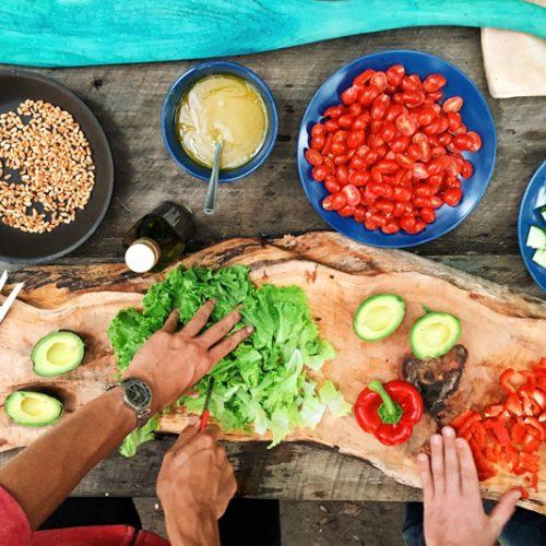 people preparing vegetarian meal
