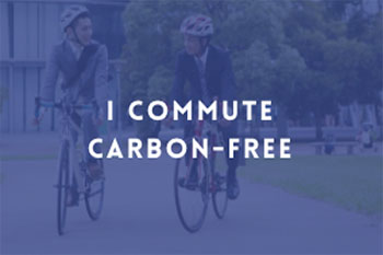 "image of two men riding bicycles with text overlay ""I commute carbon-free"""
