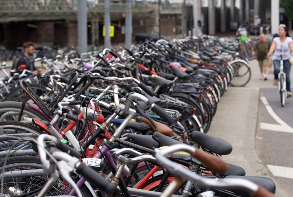 row of parked bicycles near street